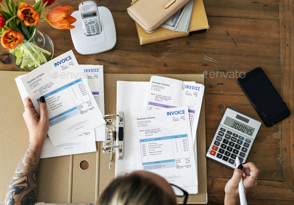 Woman doing accounting - Stock Photo - Images