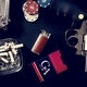 Guns, cigarettes, gambling coins on a table - PhotoDune Item for Sale