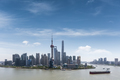 aerial view of shanghai skyline and huangpu river with blue sky - PhotoDune Item for Sale
