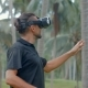 Man Using Virtual Reality Headset in the Jungle - VideoHive Item for Sale