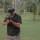 Man with Weapon Playing Virtual Reality Game in the Jungle - VideoHive Item for Sale
