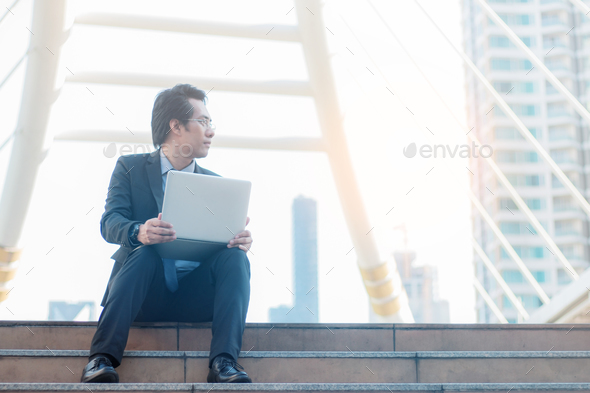 business man on a staircase - Stock Photo - Images