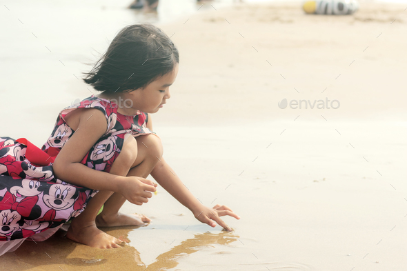 girls are playing on beach - Stock Photo - Images