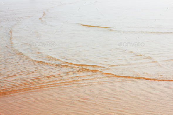 Water on beach with sunlight - Stock Photo - Images