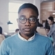 Happy African American Young Office Worker in Glasses Staring at Camera. Stylish Graphic Designer - VideoHive Item for Sale
