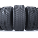 Car tires in row on white background. New black wheel tyres for - PhotoDune Item for Sale