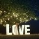 Young Couple in Love in Evening Dresses are Dancing Near Love Light Letters - VideoHive Item for Sale