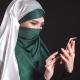 Portrait of Beautiful Arabic Muslim Girl Using Mobile Phone - VideoHive Item for Sale