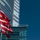 Latvian Flag in Front of an Office Skyscraper Building on a Sunny Summer Day - VideoHive Item for Sale
