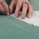 the Woman Is Applying a Pattern on the Fabric. the Designer of Clothes Draws Chalk on a Tissue - VideoHive Item for Sale