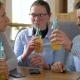 Three Friends Sit in a Cafe, Drink Juice and Have Fun Communicating - VideoHive Item for Sale
