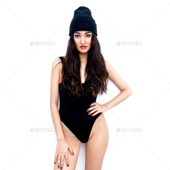 41d8e05d020 Sexy brunette in black body and beanie cap. Swag style - Stock Photo -  Images