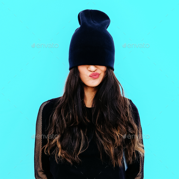 3fc51360c5d Emotional brunette in black beanie cap. Stylish urban look - Stock Photo -  Images