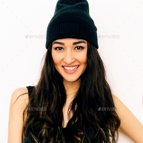 Happy brunette Girl in black clothing and beanie cap. Swag style - Stock Photo - Images