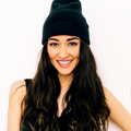 Happy brunette Girl in black clothing and beanie cap. Swag style - PhotoDune Item for Sale