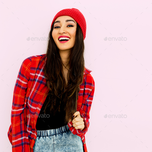 Happy brunette Girl  Fashion  Checkered shirt and beanie cap. Tr - Stock Photo - Images