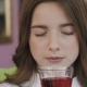Portrait of Young Girl Drinks a Juice with Pleasure - VideoHive Item for Sale