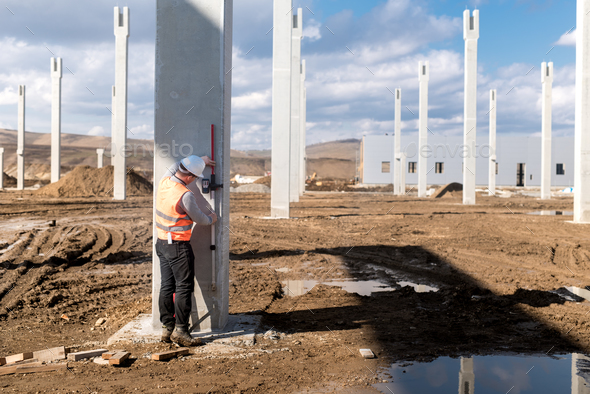 Industrial civil engineer working on construction site  Professional  surveyor measuring level