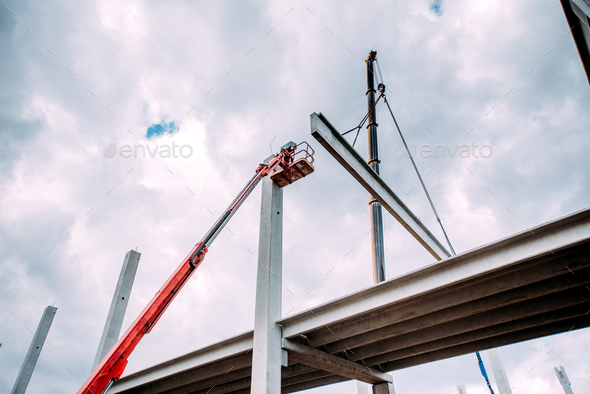 Details of construction site with crane lifting prefabricated concrete framework - Stock Photo - Images