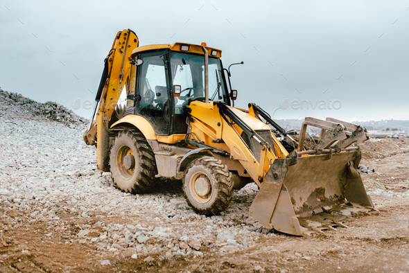 save off e58a5 31d96 Industrial backhoe excavator loader and bulldozer machinery on construction  site