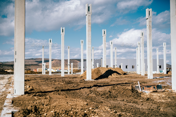 Industrial construction site with prefabricated concrete pillars - Stock Photo - Images