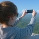 a Woman Doing Sefi with a View of the Magnificent Mountains. Slow Shooting - VideoHive Item for Sale