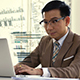 Asian Business Man Looking Intense At The Sales Figures On The Computer - VideoHive Item for Sale