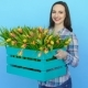 Young Woman Holding a Box of Fresh Blossoming Tulips - VideoHive Item for Sale
