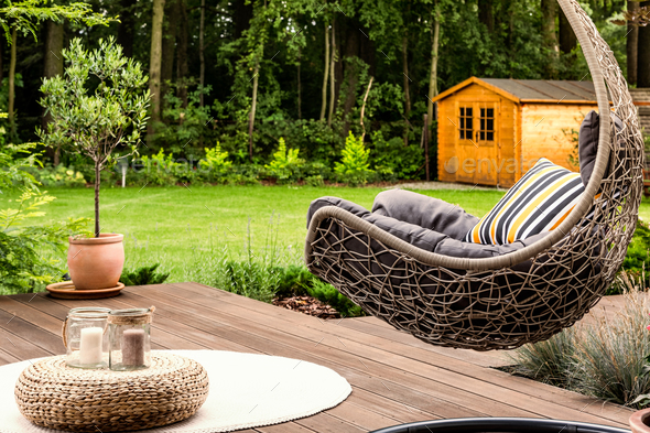 Hanging chair in the garden - Stock Photo - Images