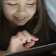 Little Girl Ten Years Uses Digital Tablet Under Cover, at Night - VideoHive Item for Sale