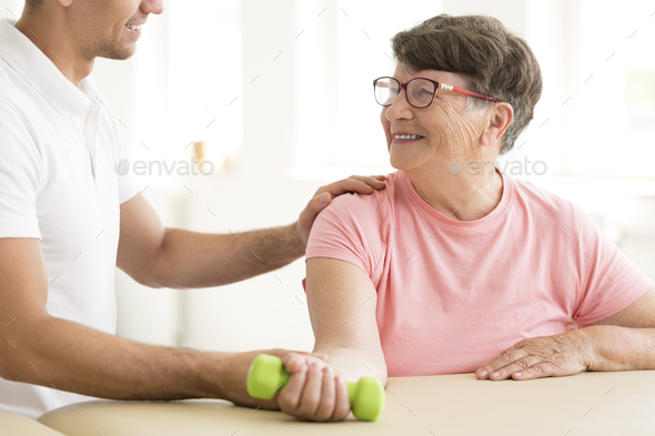 Older woman in physical rehabilitation - Stock Photo - Images