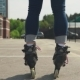 Female Legs in Roller Skates on Asphalt in City - VideoHive Item for Sale