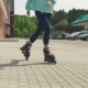 Women's Legs Riding on Roller Skates on City Street - VideoHive Item for Sale