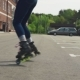 Women's Legs in Roller Skates Whirl Around on Asphalt Road in City - VideoHive Item for Sale