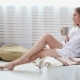 Woman in White Man's Shirt Drinking Coffee in Bed - VideoHive Item for Sale
