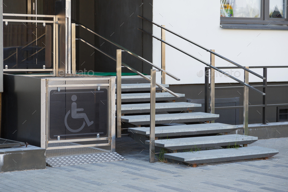 Living house entrance equipped with special lifting platform for wheelchair users - Stock Photo - Images