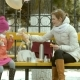 Beautiful Girl and Her Mom Sitting on a Park Bench and Eating a Delicious Dessert and Drinking - VideoHive Item for Sale
