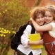 Schoolchildren, Brother and Sister, Boy and Girl Hug Against the Background of a Blossoming Spring - VideoHive Item for Sale