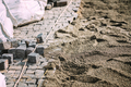 Construction of pavement path, road or sidewalk with cobblestone granite stones in urban city. - PhotoDune Item for Sale