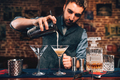 barman pouring fancy cocktail in bar at party. Manhattan cocktail beverage in nightclub - PhotoDune Item for Sale