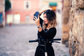 Portrait of cheerful girl smiling and taking photographs - PhotoDune Item for Sale