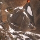 Aerial View of a Rock Climber Climbing a Steep Cliffs During a Sunny Winter Day. - VideoHive Item for Sale