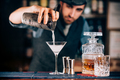 Martini preparation. Dry martini details, close up of alcoholic beverage at bar - PhotoDune Item for Sale