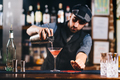 Portrait of vintage barman workin in bar. Pouring and preparing cocktails - PhotoDune Item for Sale