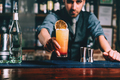 Portrait of handsome bartender serving perfect summer drink - PhotoDune Item for Sale