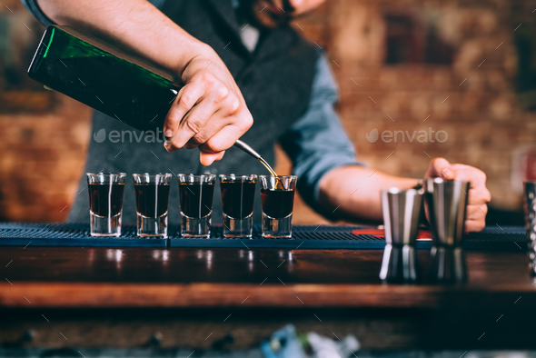 Close up details of bartender serving alcoholic drinks at party - Stock Photo - Images