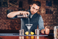 Close up of barman hands adding ice and tequila to modern urban cocktails. - PhotoDune Item for Sale