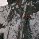 Aerial View of a Rock Climber Climbing a Steep Cliffs During a Sunny Winter Day - VideoHive Item for Sale