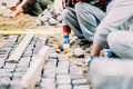 onstruction worker installing cobblestone pavement on path - PhotoDune Item for Sale