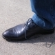 Guy Ties His Shoelaces Close upThe Guy Stops and Ties the Laces on the Shoes - VideoHive Item for Sale